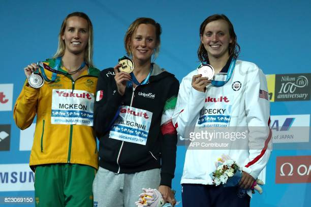 Australia's Emma McKeon Italy's Federica Pellegrini and USA's Katie Ledecky pose during the podium ceremony for the women's 200m freestyle final...