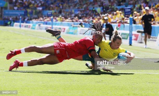 Australia's Emma Tonegato scores a try against Canada in the Women's Semi Finals during Rugby Sevens on day 11 of the Gold Coast 2018 Commonwealth...