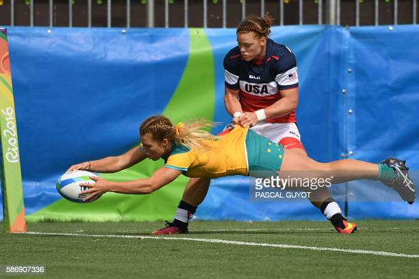 Australia's Emma Tonegato scores a try as she is tackled by USA's Alev Kelter in the womens rugby sevens match between Australia and USA during the...