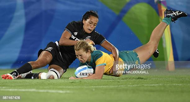 Australia's Emma Tonegato scores a try in the womens rugby sevens gold medal match between New Zealand and Australia during the Rio 2016 Olympic...
