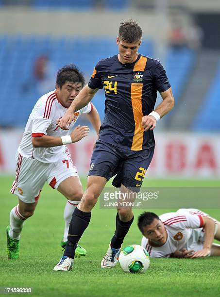 Australia's Erik Endel Paartalu dribbles the ball against China during their East Asian Cup football match in Seoul on July 28 2013 The match was...