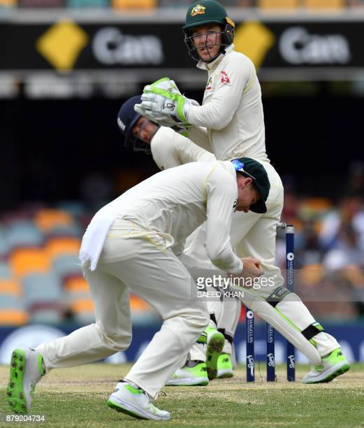 Australia's fielder Steve Smith celebrates a successful catch off England's batsman Dawid Malan as wicketkeeper Tim Paine looks on during the fourth...