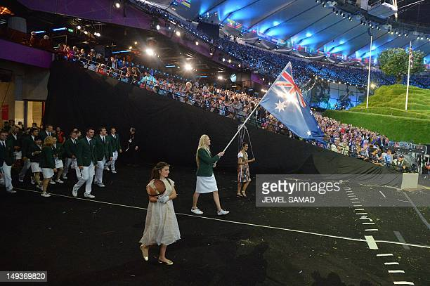 Australia's flagbearer Lauren Jackson leads her delegation during the opening ceremony of the London 2012 Olympic Games on July 27 2012 at the...
