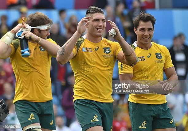 Australia's flanker Ben McCalman Australia's flanker Sean McMahon and Australia's scrum half Nick Phipps gestures on the pitch after the Pool A match...