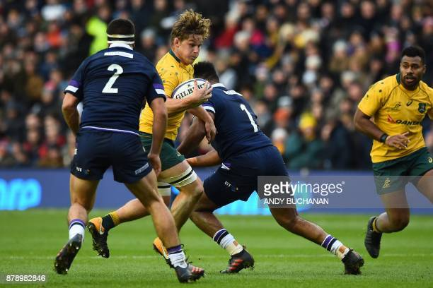 Australia's flanker Michael Hooper is tackled by Scotland's prop Darryl Marfo during the autumn international rugby union test match between Scotland...