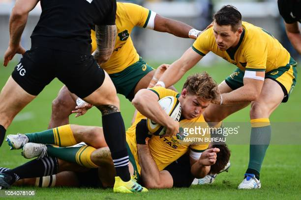 TOPSHOT Australia's flanker Michael Hooper is tackled during the Bledisloe Cup rugby union Test match between the New Zealand All Blacks and...