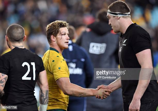 Australia's flanker Michael Hooper shakes hands with New Zealand's lock Brodie Retallick after the Rugby Championship test match between Australia...