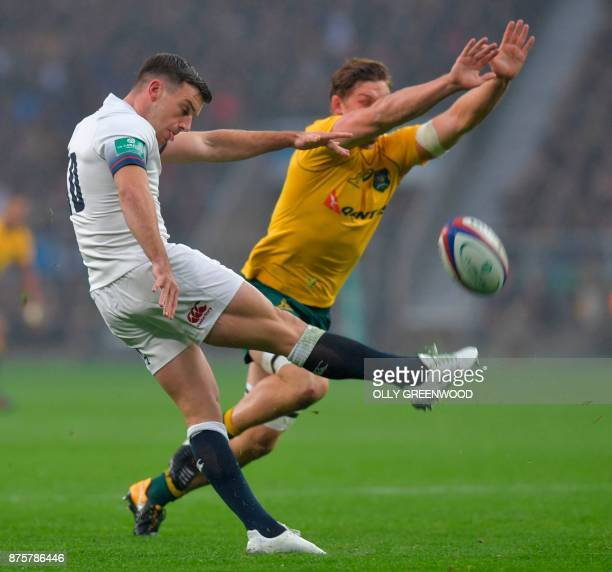 Australia's flanker Michael Hooper tries to charge down England's flyhalf George Ford's kick during the international rugby union test match between...