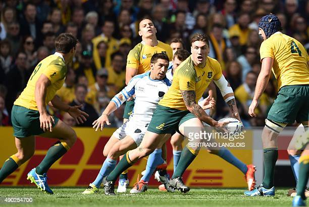Australia's flanker Sean McMahon prepares to pass the ball during the Pool A match of the 2015 Rugby World Cup between Australia and Uruguay at Villa...