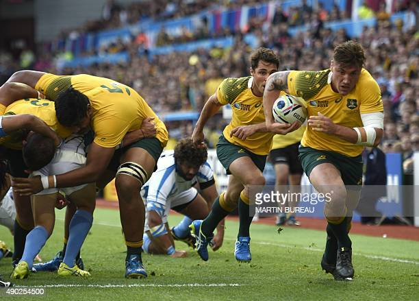 Australia's flanker Sean McMahon runs in Australia's first try during the Pool A match of the 2015 Rugby World Cup between Australia and Uruguay at...