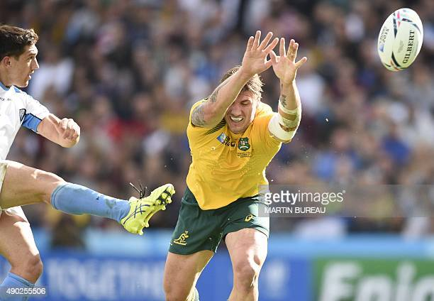 Australia's flanker Sean McMahon tries to charge down a kick from Uruguary's scrum half Agustin Ormaechea during the Pool A match of the 2015 Rugby...