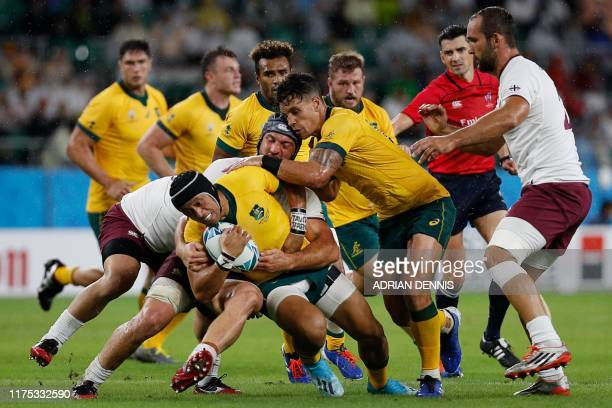 Australia's fly-half Christian Lealiifano is tackled during the Japan 2019 Rugby World Cup Pool D match between Australia and Georgia at the Shizuoka...