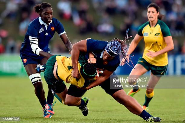 Australia's flyhalf Tui Ormsby is tackled by France's number eight Safi N'Diaye next to France's flanker Coumba Diallo during the IRB Women's Rugby...