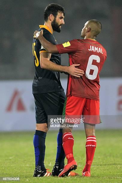 Australia's football captain Mile Jedinak shakes hand with Bangladesh football player Jamal Bhuyan after the Asia Group B FIFA World Cup 2018...