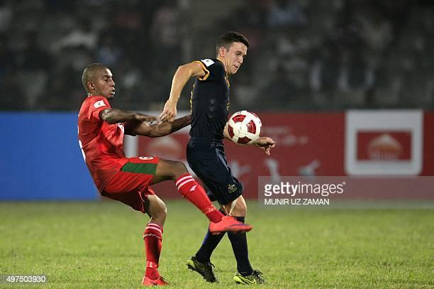 Australia's football player Matt Mckay vies for the ball with Bangladesh football player Jamal Bhuyan during the Asia Group B FIFA World Cup 2018...