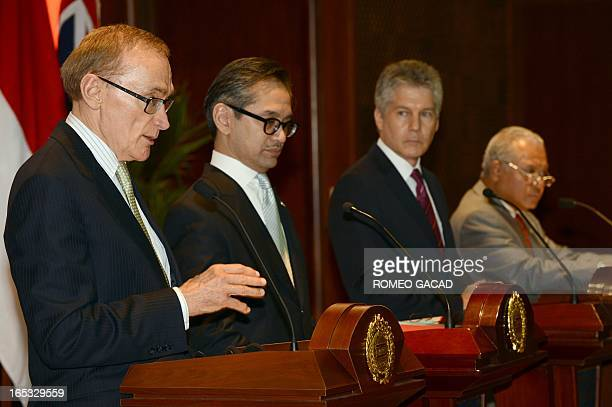Australia's Foreign Minister Bob Carr delivers his address as Defense Minister Stephen Smith and Indonesia's Foreign Minister Marty Natalegawa and...