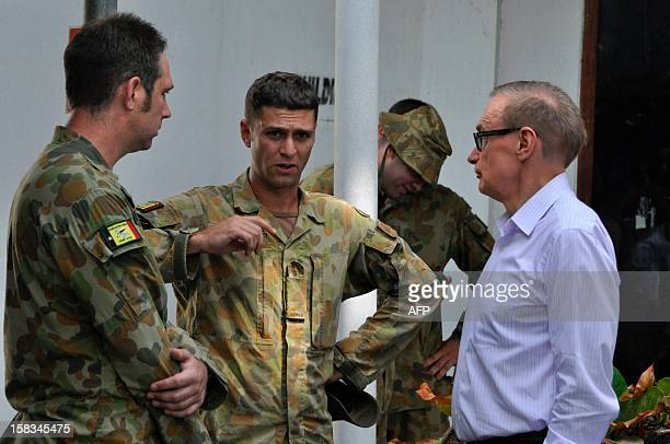 Australia's Foreign Minister Bob Carr greets the remaining unit of Australian troops part of the International Stabilisation Force working with UN...