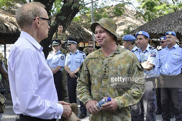 Australia's Foreign Minister Bob Carr speaks to an Australian soldier part of the International Stabilisation Force working with UN peace keeping...