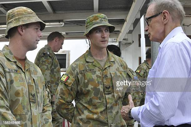 Australia's Foreign Minister Bob Carr speaks to the remaining unit of Australian troops part of the International Stabilisation Force working with UN...