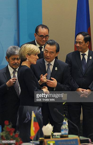 Australia's Foreign Minister Julia Bishop and China's Foreign Minister Wang Yi talk as they attend a ceremony to launch the logo for the ASEAN...