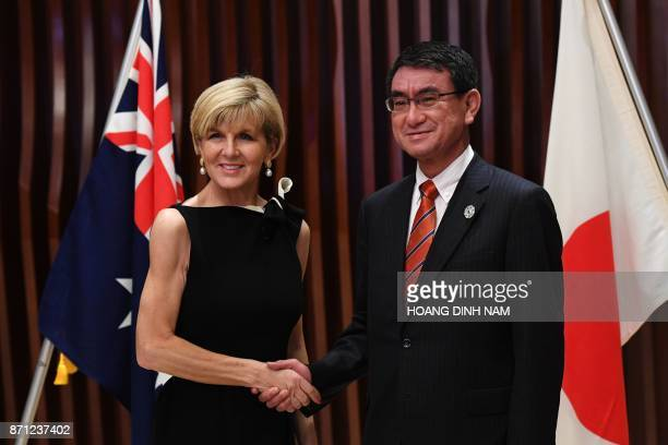 Australia's Foreign Minister Julie Bishop shakes hands with Japan's Foreign Minister Taro Kono ahead of their bilateral meeting before the...