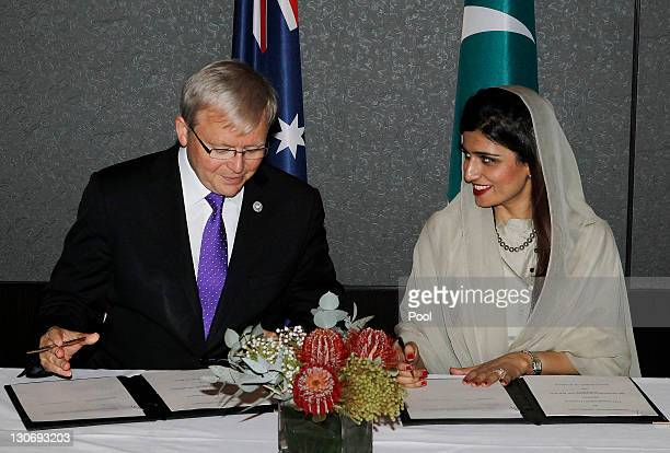 Australia's Foreign Minister Kevin Rudd and Pakistan's Foreign Minister Hina Rabbani Khar sign a Memorandum of Understanding at a bilateral meeting...