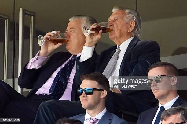 Australia's former prime minister Bob Hawke enjoys a beer as he watches Australia play Pakistan on the second day of the third cricket Test match at...