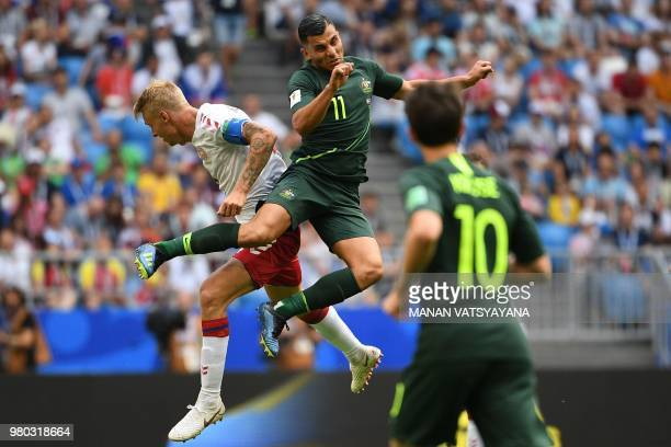 Australia's forward Andrew Nabbout and Denmark's defender Simon Kjaer go up for a header during the Russia 2018 World Cup Group C football match...
