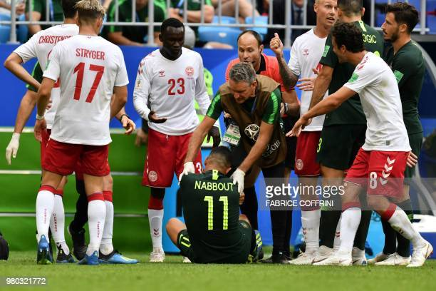 Australia's forward Andrew Nabbout gets attention for an injury during the Russia 2018 World Cup Group C football match between Denmark and Australia...