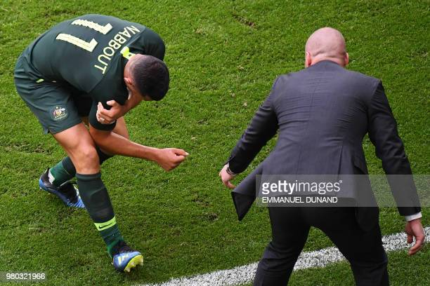 Australia's forward Andrew Nabbout holds his shoulder as he reacts during the Russia 2018 World Cup Group C football match between Denmark and...
