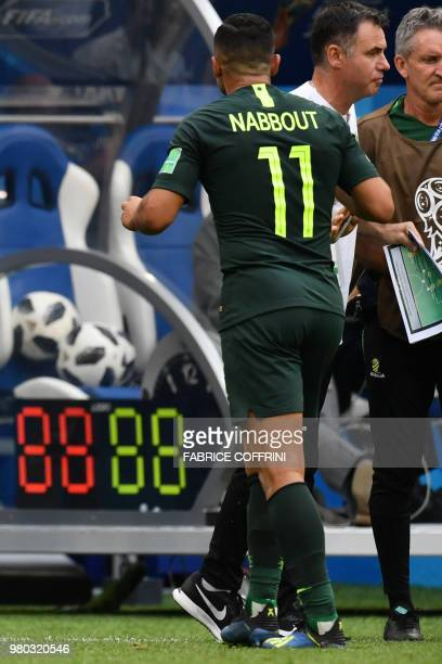 Australia's forward Andrew Nabbout leaves the field injured during the Russia 2018 World Cup Group C football match between Denmark and Australia at...