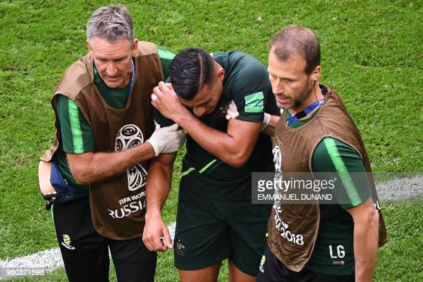 Australia's forward Andrew Nabbout reacts as he is assisted during the Russia 2018 World Cup Group C football match between Denmark and Australia at...