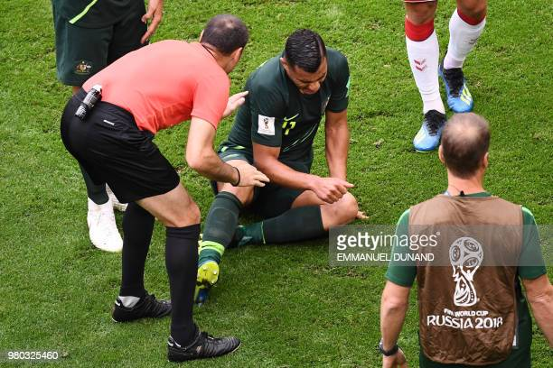 Australia's forward Andrew Nabbout reacts on the ground during the Russia 2018 World Cup Group C football match between Denmark and Australia at the...