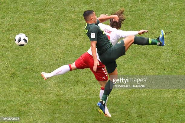 TOPSHOT Australia's forward Andrew Nabbout vies for the ball with Denmark's midfielder Lasse Schone during the Russia 2018 World Cup Group C football...