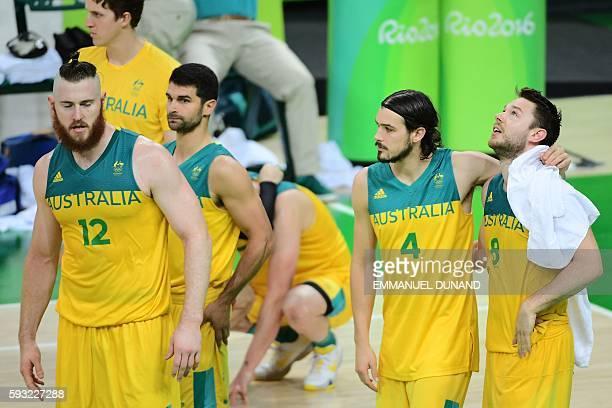 Australia's forward Aron Baynes, Australia's guard Kevin Lisch, Australia's shooting guard Chris Goulding and Australia's guard Matthew Dellavedova...