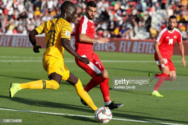 Australia's forward Awer Mabil fights for the ball with Palestine's midfielder Musab Battat during the 2019 AFC Asian Cup group B football match...