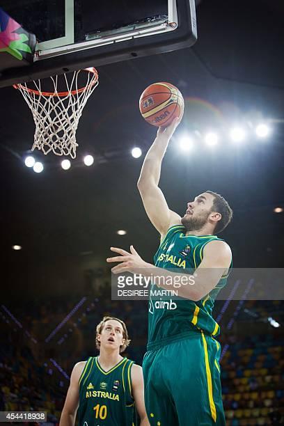 Australia's forward Cameron Bairstow looks at Australia's guard Adam Gibson during the 2014 FIBA World basketball championships group D match...