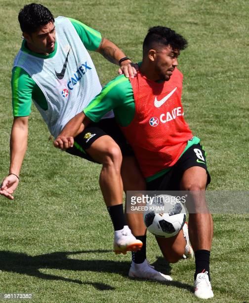 Australia's forward Dimitri Petratos and midfielder Massimo Luongo take part in a training session of Australia national team in Kazan on June 22...