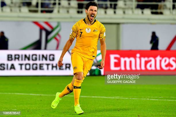 Australia's forward Mathew Leckie celebrates scoring a penalty during the 2019 AFC Asian Cup Round of 16 football match between Australia and...