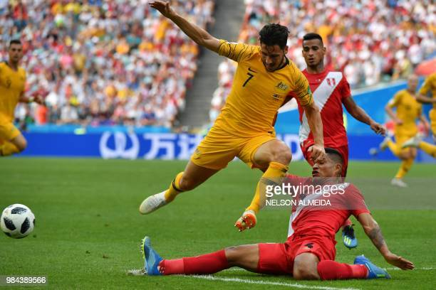 Australia's forward Mathew Leckie is tackled by Peru's defender Anderson Santamaria during the Russia 2018 World Cup Group C football match between...