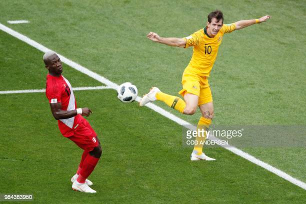Australia's forward Robbie Kruse vies for the ball with Peru's defender Luis Advincula during the Russia 2018 World Cup Group C football match...