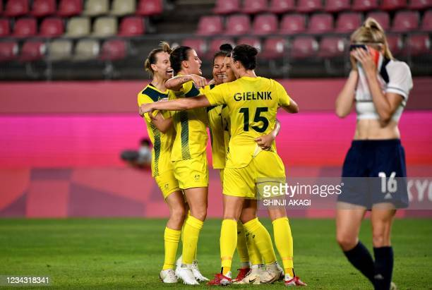 Australia's forward Sam Kerr is celebrated her goal by teammates making it 4-2 lead during the extra second half of the Tokyo 2020 Olympic Games...
