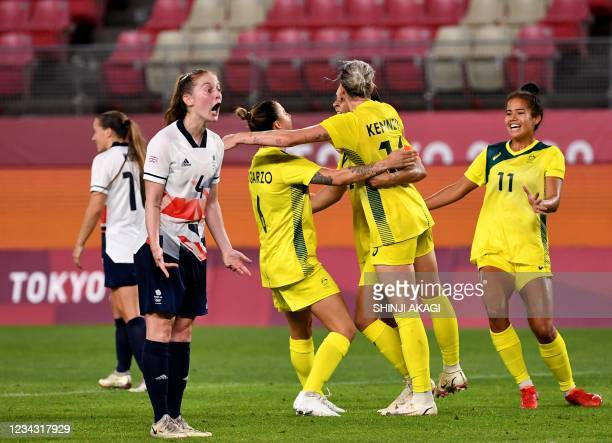 Australia's forward Sam Kerr is celebrated her goal with teammates while Britain's midfielder Keira Walsh reacts during first extra half of the Tokyo...