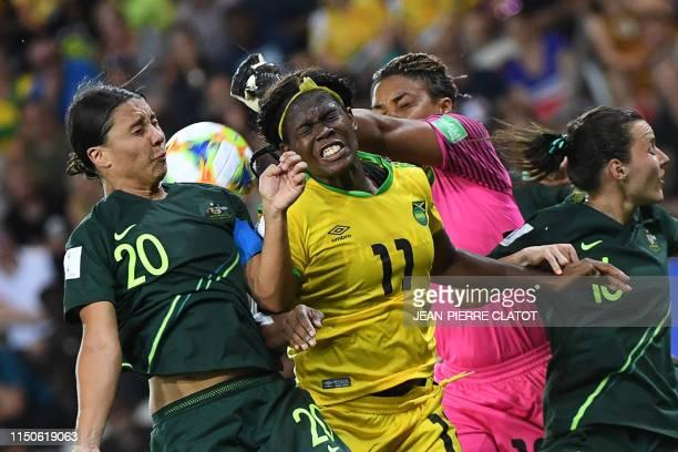 Australia's forward Samantha Kerr vies for the ball with Jamaica's forward Khadija Shaw and Jamaica's goalkeeper Nicole McClure during the France...