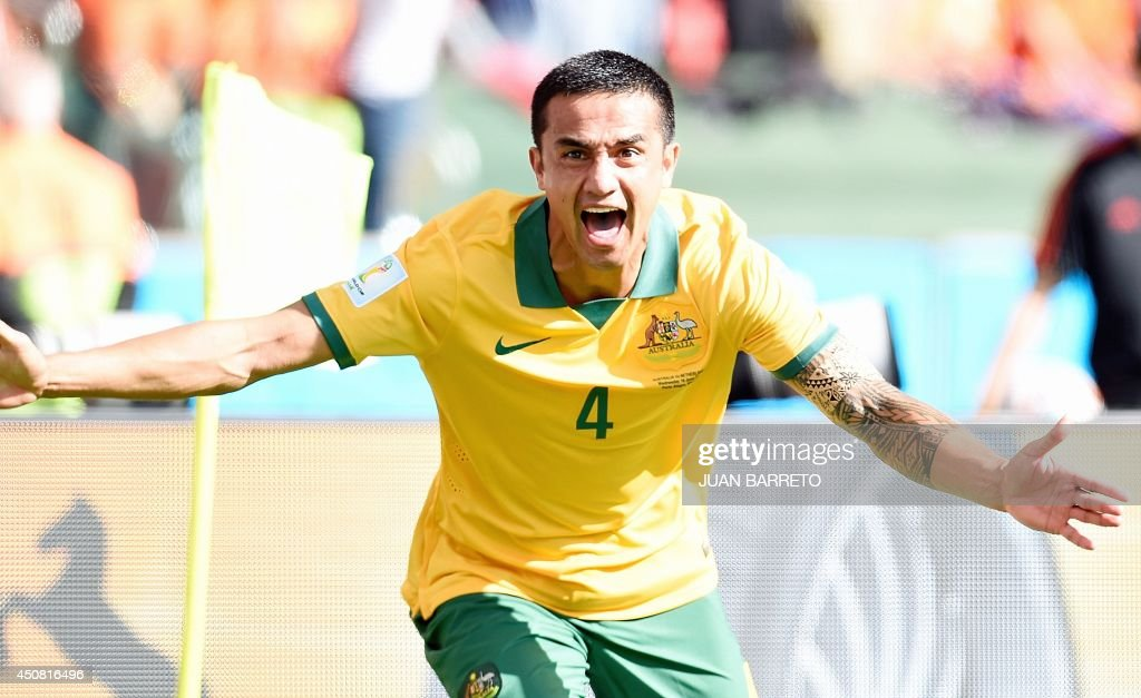 Australia's forward Tim Cahill celebrates after scoring during a Group B football match between Australia and the Netherlands at the Beira-Rio Stadium in Porto Alegre during the 2014 FIFA World Cup on June 18, 2014. AFP PHOTO / JUAN BARRETO / AFP PHOTO / Juan BARRETO