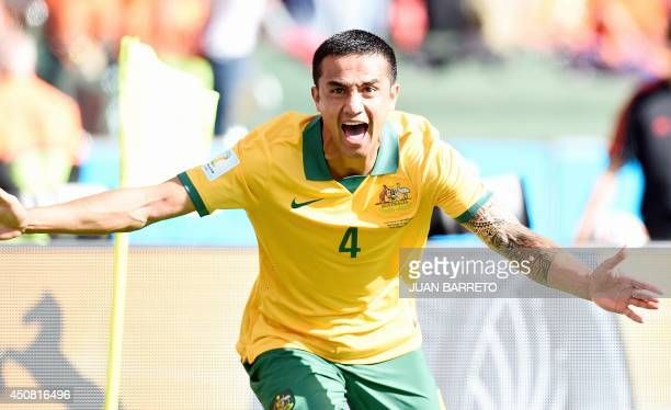 Australia's forward Tim Cahill celebrates after scoring during a Group B football match between Australia and the Netherlands at the BeiraRio Stadium...