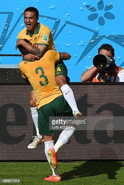 Australia's forward Tim Cahill celebrates with a teammate after scoring during a Group B football match between Australia and the Netherlands at the...
