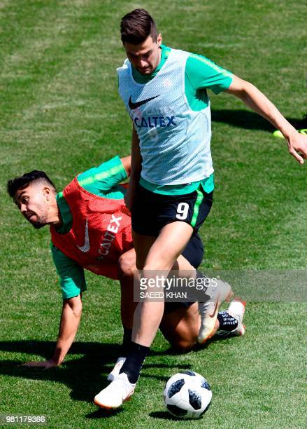 Australia's forward Tomi Juric and midfielder Massimo Luongo take part in a training session of Australia national team in Kazan on June 22 during...