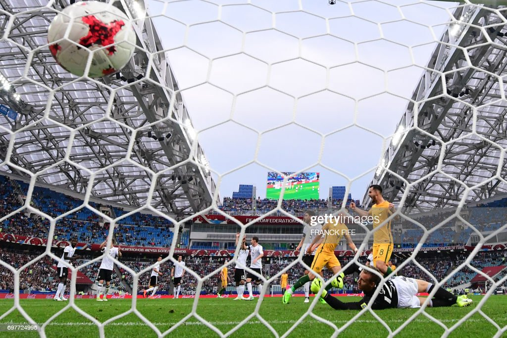 Australia's forward Tomi Juric (3rd R) scores a goal past Germany's goalkeeper Bernd Leno during the 2017 Confederations Cup group B football match between Australia and Germany at the Fisht Stadium in Sochi on June 19, 2017. /