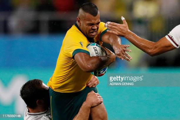 Australia's full back Kurtley Beale is tackled by Georgia's centre Merab Sharikadze and Georgia's wing Giorgi Kveseladze during the Japan 2019 Rugby...